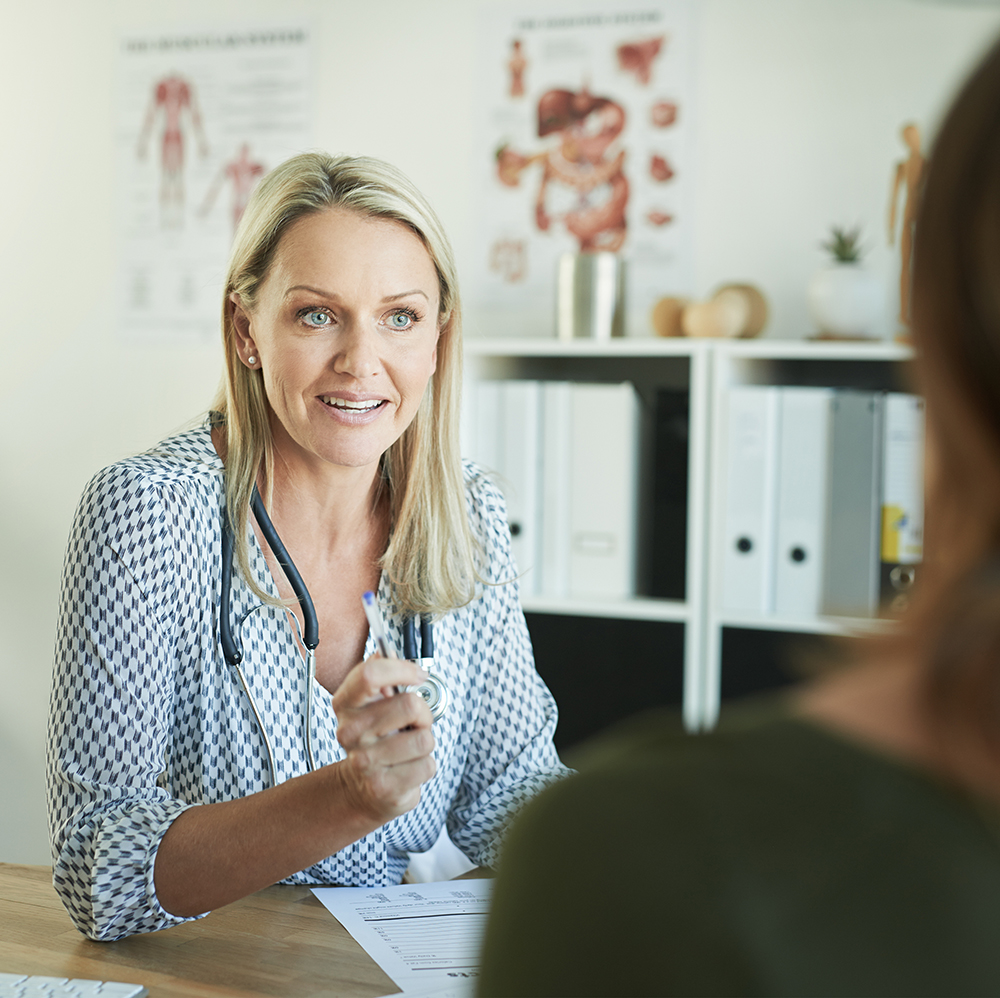 Shot of a female doctor explaining something to her patient